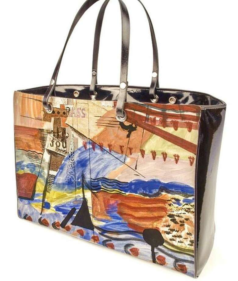 Isodora Gacel recently opened a gallery in South Norwalk featuring the more ubiquitous art one hangs, along with art one wears or totes around. This bag features artwork from her late brother and is among several fashion items that feature the work of her siblings. Photo: Contributed Photo / Connecticut Post contributed