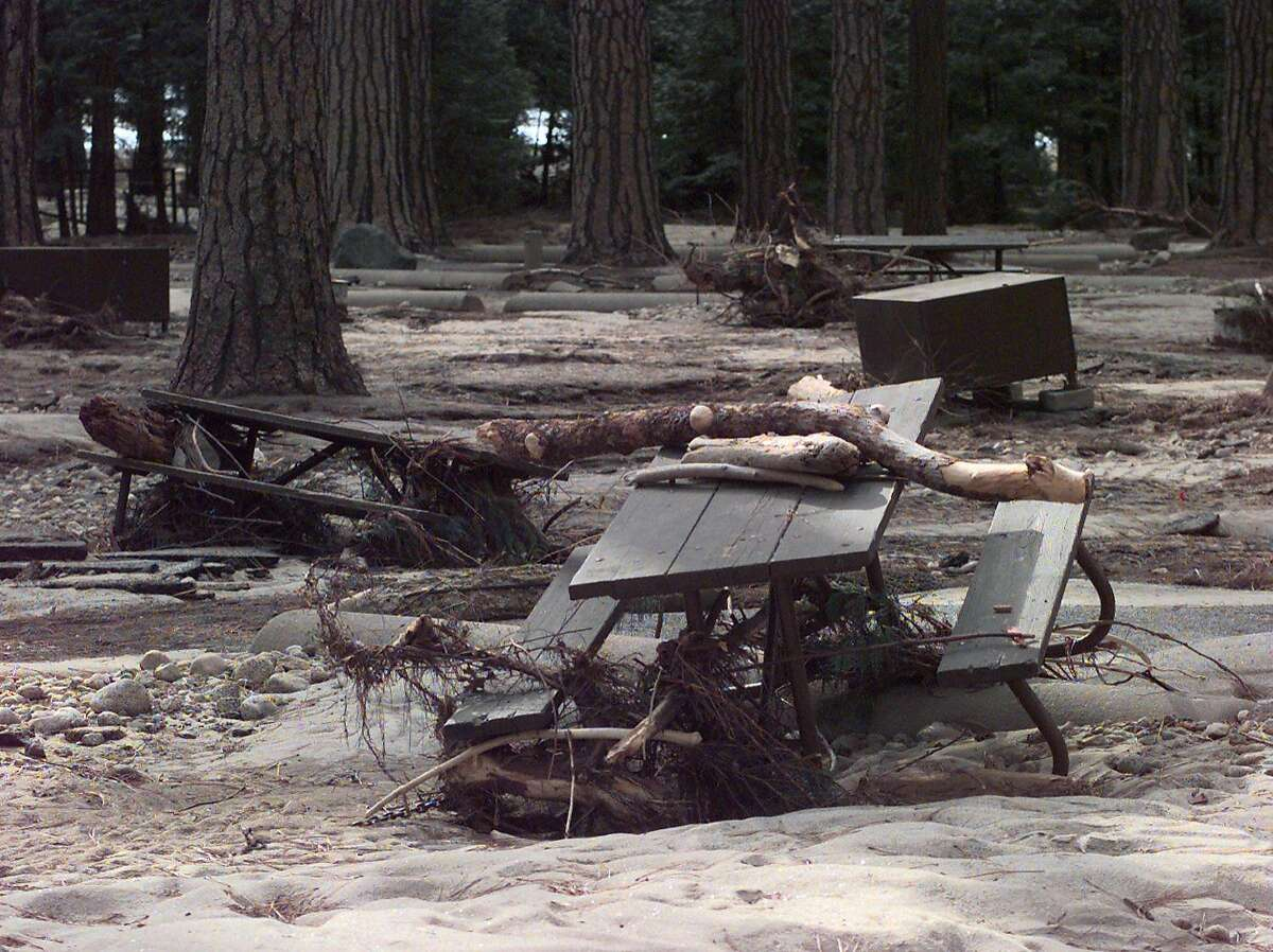 CAMPGROUND/C/08JAN97/MN/MACOR Lower Pines Campgroung with picnic tables and food boxes scattered and covered with debris following the Yosemite floods Chronicle Photo: Michael Macor