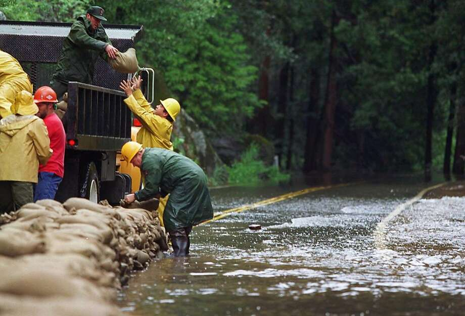 1997 Park Service workers place sandbags along Highway 140 in Yosemite park to combat devastating flooding that caused an estimated $176 million damage. Photo: RUSSELL YIP