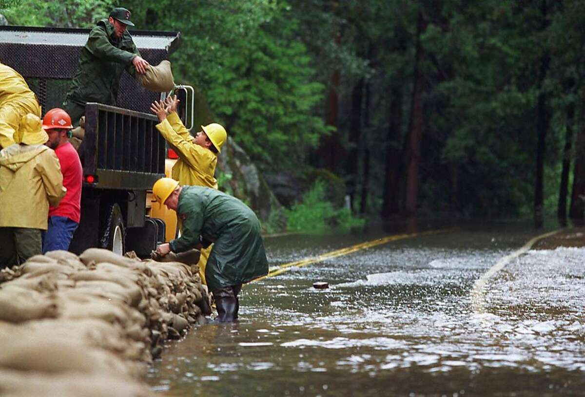 YOSEMITE2/C/16MAY96/MN/YIP-Park Service personnel sandbagged Hwy 140 inside Yosemite National Park where the Merced River crested and caused the closure of the highway. All three entrances to the park were closed Thursday. BY RUSSELL YIP/THE CHRONICLE