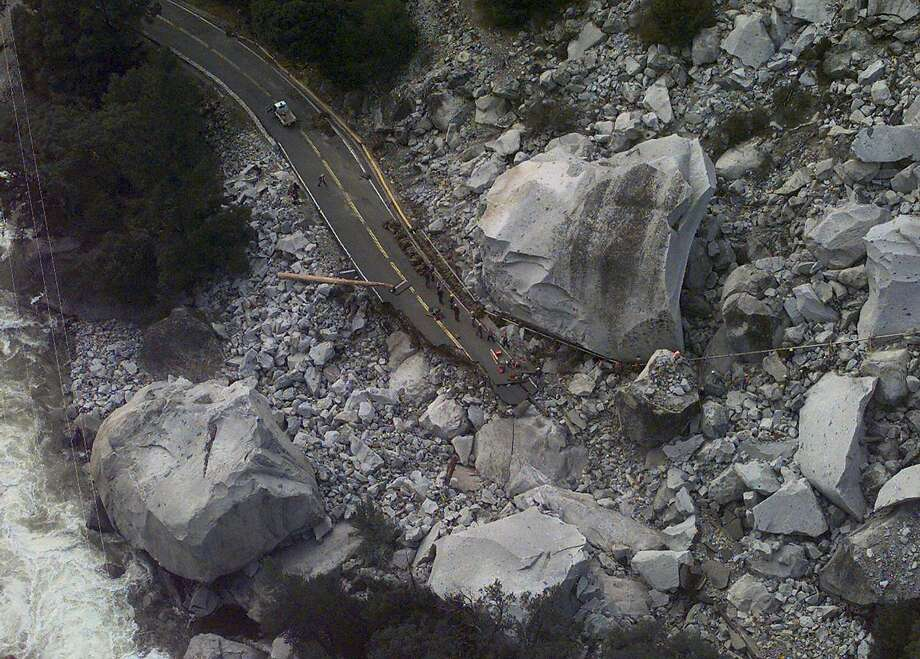 A rockslide triggered by massive rains swept away a section of Highway 140 in Yosemite National Park in January 1996. The storm trapped more than 2,000 people in the park for more than two days, and the park remained closed until March. Photo: MICHAEL MACOR