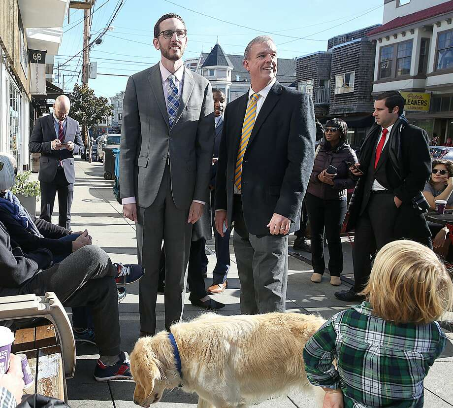 New state Sen. Scott Wiener (left) on 24th Street with his successor as District Eight supervisor, Jeff Sheehy. Photo: Liz Hafalia, The Chronicle