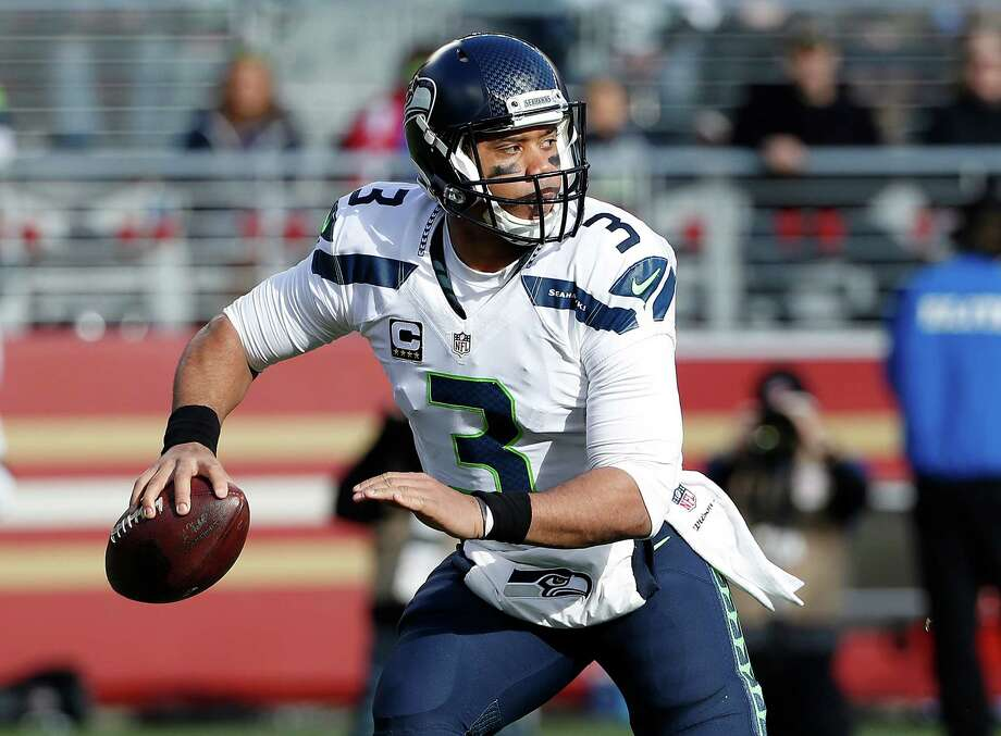 FILE - In this Jan. 1, 2017, file photo, Seattle Seahawks quarterback Russell Wilson (3) looks for a receiver during the first half of an NFL football game against the San Francisco 49ers, in Santa Clara, Calif. The Seahawks play against the Detroit Lions in a Wild Card playoff game on Saturday, Jan. 7. (AP Photo/Tony Avelar, FIle) Photo: Tony Avelar, FRE / FR155217 AP