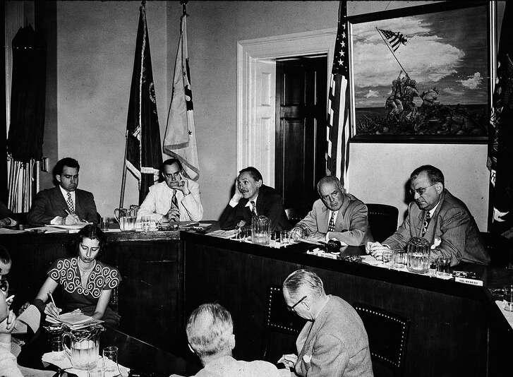 Members of the House Committee on Un-American Activities (HUAC) sit for an executive meeting, Washington DC, August 8, 1948. From left, future American President Richard Nixon (1913 - 1994), chief investigator Robert Stripling, and U.S. Representatives John McDowell (1902 - 1957), committee chairman J. Parnell Thomas (1895 - 1970), and F. Edward Hebert (1901 - 1979). (Photo by New York Times Co./Getty Images)