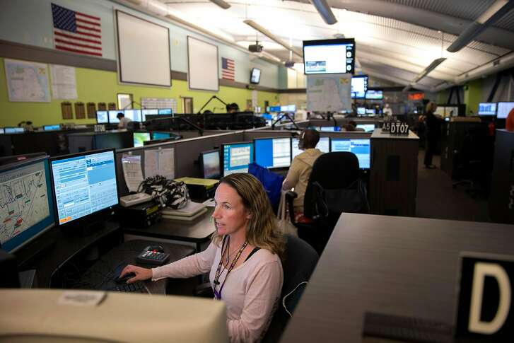 Kate Buhagiar, a dispatcher, takes a call at the 911 dispatch center, on Friday, Oct. 28, 2016 in San Francisco, Calif.