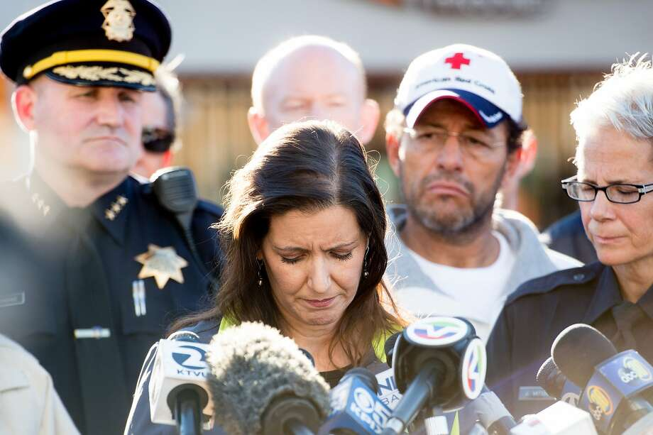 Oakland Mayor Libby Schaaf pauses during a press conference at the scene of a fatal fire in Oakland, Calif., on Saturday, Dec. 3, 2016. Photo: Noah Berger, Special To The Chronicle