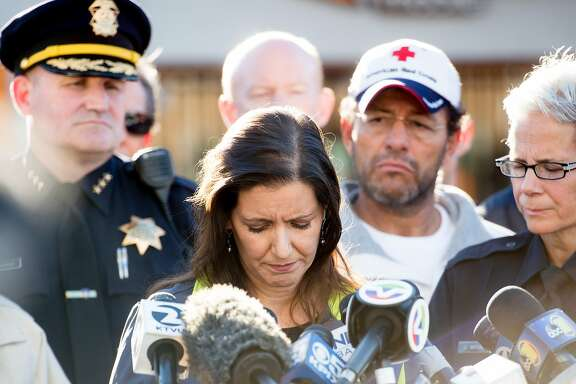 Oakland Mayor Libby Schaaf pauses during a press conference at the scene of a fatal fire in Oakland, Calif., on Saturday, Dec. 3, 2016.