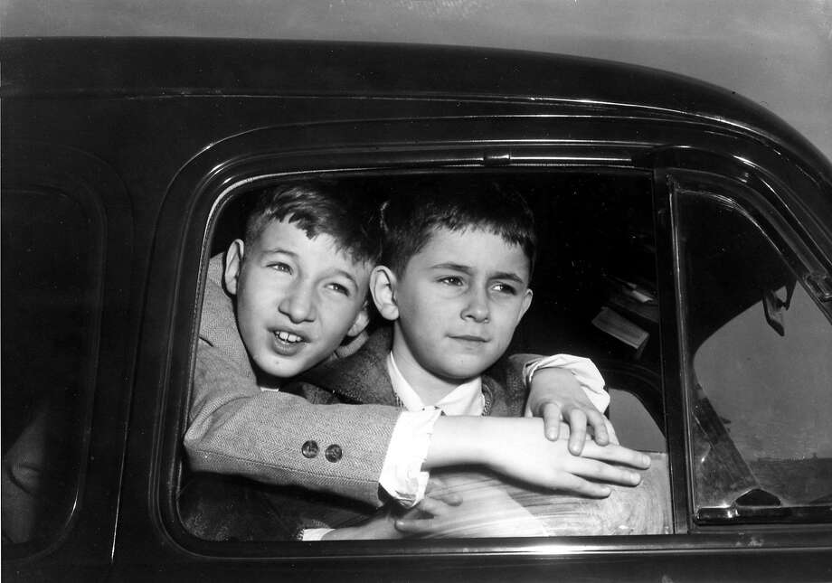 Michael Rosenberg, 9, left, and his brother Robert, 5, children of spies Julius and Ethel Rosenberg, prepare to leave Sing Sing Prison in Ossining, N.Y., after visiting their parents on death row, Feb. 14, 1953.  The Rosenberg's executive clemency appeal has been denied by U.S. President Dwight Eisenhower.  (AP Photo) Photo: ASSOCIATED PRESS