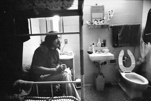 Former AIM activist Leonard Peltier, a Chippewa-Lakota Indian serving a life sentence for the murder of 2 FBI agents he maintains he didn't commit, writing letter as he sits on his bunk next to sink & toilet in his cell at Leavenworth Penitentiary, KS.  (Photo by Taro Yamasaki/The LIFE Images Collection/Getty Images)