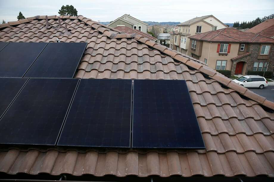 SunPower solar panels are seen installed on a new home being built at a Mertiage Home's community called Kingston Square on Friday, January 6,  2017 in Hayward, Calif. Photo: Lea Suzuki, The Chronicle