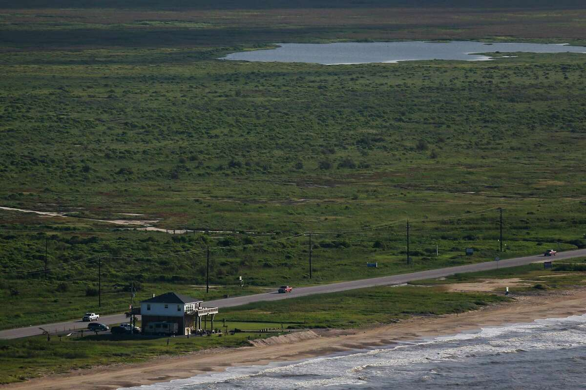 """A lone house sits along the beach on the Bolivar Peninsula. A dike, called the """"Ike Dike,"""" is being proposed to protect Galveston, Bolivar and the Galveston Bay area from storm surges. ( Michael Ciaglo / Houston Chronicle )"""