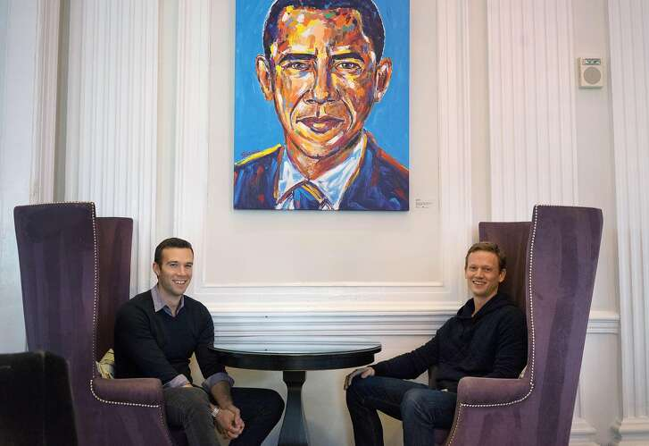 """Together the voice behind the popular snarky partisan podcast called """"Keepin' it 1600,"""" President Obama's long time speech writer, Jon Favreau, left,  and Obama White House veteran, Tommy Vietor, sit in the lobby of the W Hotel on Friday January 6, 2017 in Washington D.C. The two, with the help of another entrepreneur Jon Lovett (not shown), are leaving their West Coast consulting jobs to bootstrap a new media company they are calling """"Crooked Media."""" Their new podcast dubbed """"Pod Save America"""" debuts Monday."""