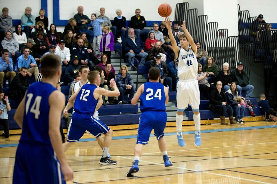 BRITTNEY LOHMILLER | blohmiller@mdn.net Meridian's Lucas Lueder shoots for three points in the first half of the Friday evening game against Gladwin. Photo: Brittney Lohmiller/Midland Daily News/Brittney Lohmiller