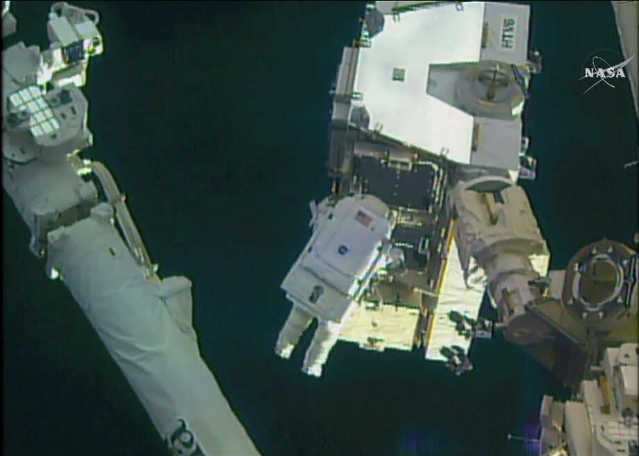 In this still image taken from video provided by NASA, astronaut Peggy Whitson takes a spacewalk outside the International Space Station on Friday, Jan. 6, 2016.  Whitson and Commander Shane Kimbrough went spacewalking  to hook up fancy new batteries on the International Space Station's sprawling power grid. (NASA via AP) Photo: HOGP / NASA