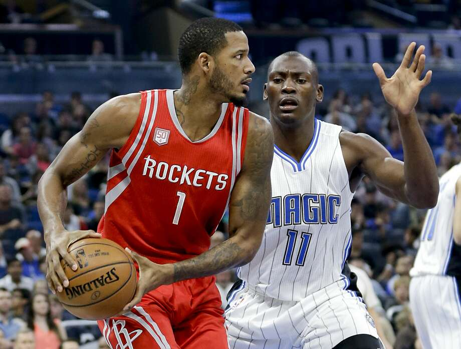 Houston Rockets' Trevor Ariza (1) looks to pass the ball around Orlando Magic's Bismack Biyombo (11) during the first half of an NBA basketball game, Friday, Jan. 6, 2017, in Orlando, Fla. (AP Photo/John Raoux) Photo: John Raoux/Associated Press