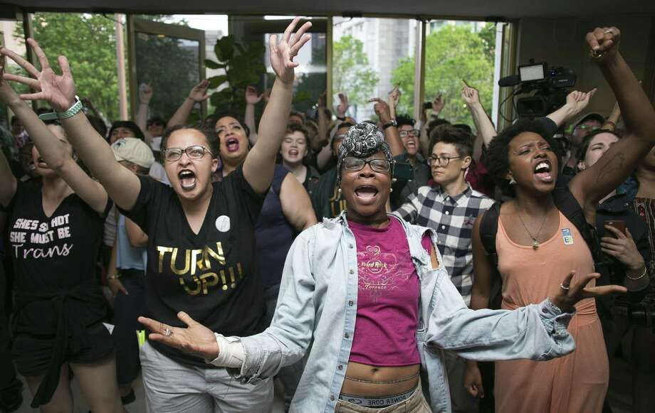 Krys Didtrey, left, and Gloria Merriweather, center, of Charlotte, N.C. lead the chants in opposition to House Bill 2 during a protest in the lobby of the State Legislative Building in Raleigh, N.C. on Monday April 25, 2016. Texas business leaders worry the state could see $8.5 billion in economic losses if lawmakers pass a similar law here. Photo: Robert Willett /Associated Press / The News & Observer