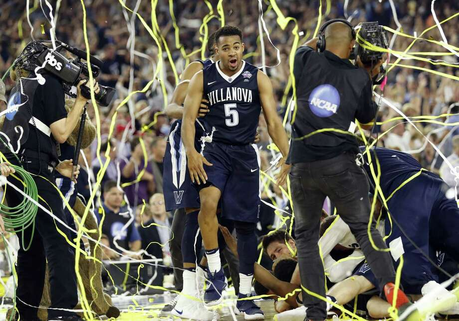 In this April 4, 2016, file photo Villanova's Phil Booth celebrates after the NCAA Final Four tournament college basketball championship game against North Carolina, in Houston. Officials and business leaders in San Antonio fear the NCAA could pull the Final Four tournament from San Antonio if state lawmakers pass a law barring transgender men and women from using restrooms corresponding with their gender identity. Photo: Eric Gay /Associated Press / Copyright 2016 The Associated Press. All rights reserved.