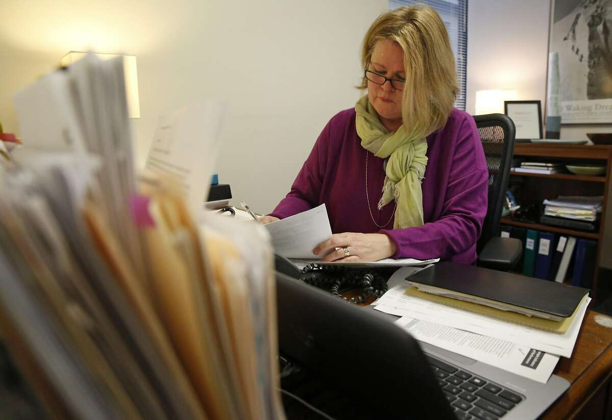 Executive Director of San Francisco Ethics Commission LeeAnn Pelham works in her office on finalizing job postings Jan. 4, 2017 in San Francisco, Calif. Pelham plans on increasing her staff by 50 percent.