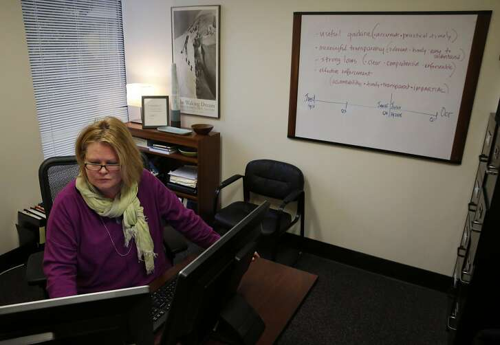 Executive Director of San Francisco Ethics Commission LeeAnn Pelham works on finalizing job postings in her office Jan. 4, 2017 in San Francisco, Calif. Pelham plans on increasing her staff by 50 percent.