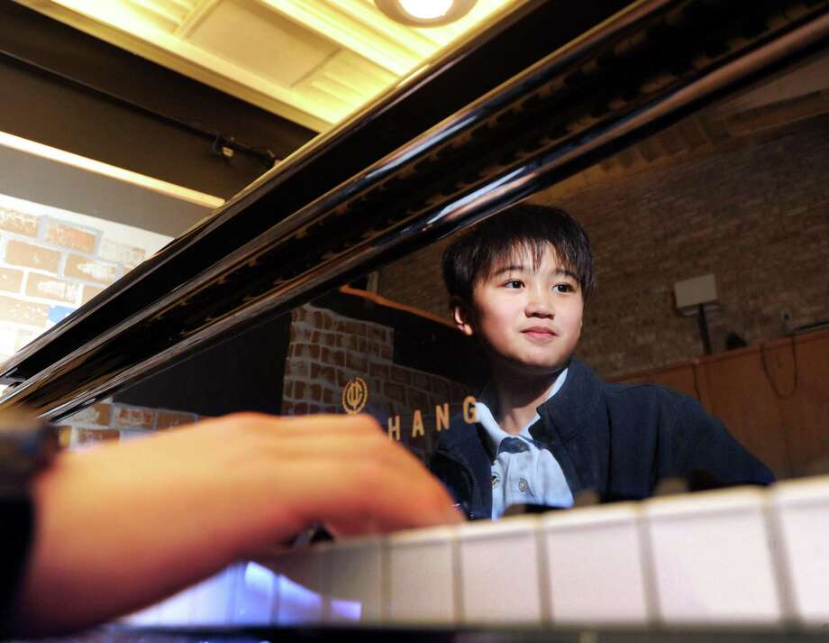 Whitby School 5th grade student Peter Liu, 10, plays the piano at the school in Greenwich, Conn., Friday, Jan. 6, 2017. Liu has been making a name for himself as a pianist, winning international awards. Photo: Bob Luckey Jr. / Hearst Connecticut Media / Greenwich Time