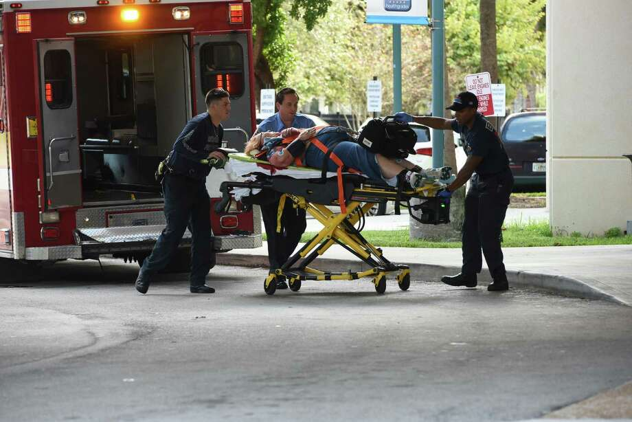 A shooting victim is wheeled into Broward Health Medical Center in Fort Lauderdale, Fla. A doctor there said the eight people who were wounded were in stable condition. Photo: Taimy Alvarez / TNS / Sun Sentinel
