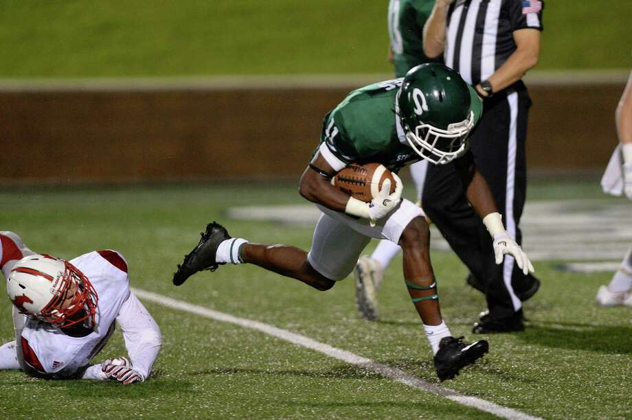 Jaetavian Toles (11) of Stratford carries the ball across the goal line for a touchdown in the third quarter of a high school football game between the Memorial Mustangs and the Stratford Spartans on Friday October 14, 2016 at Tulley Stadium, Houston. Toles was voted 15-6A Return Specialist. Photo: Craig Moseley, Staff / ©2016 Houston Chronicle