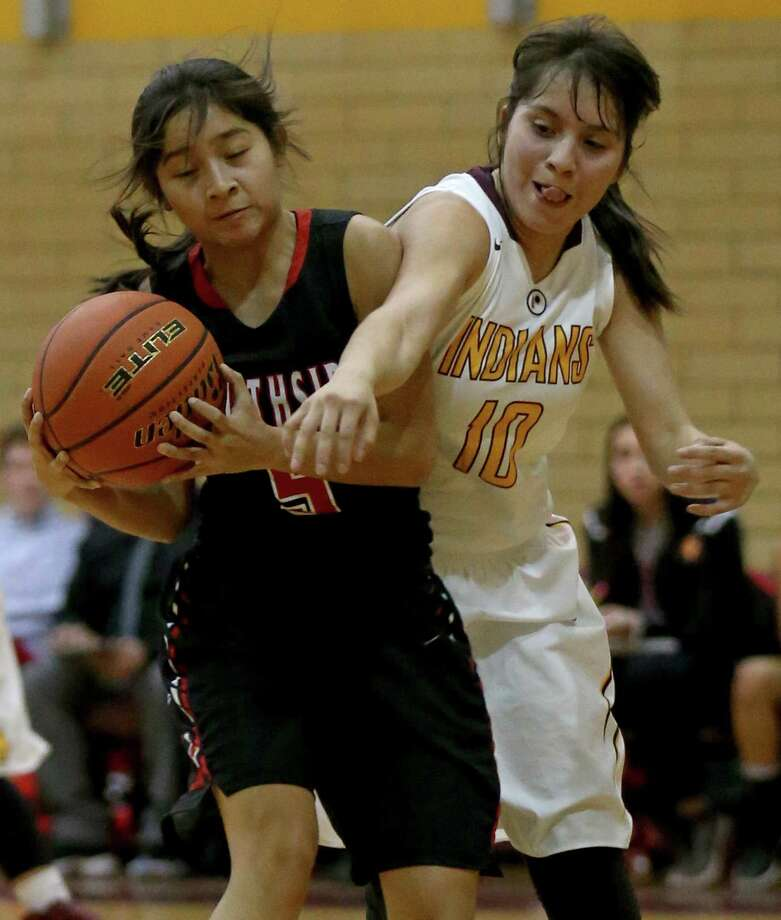 Southside's Marcelina Lopez and Harlandale's Deanna Chavarria struggle for control of the ball during first half action held Friday Jan. 6, 2017 at Harlandale High School. Photo: Edward A. Ornelas, Staff / San Antonio Express-News / © 2017 San Antonio Express-News