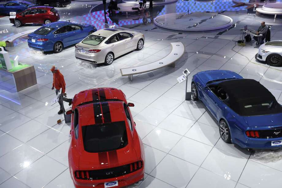 The Ford display is seen at the 2017 North American International Auto show in Detroit. Fresh off a record year for U.S. auto sales, carmakers meet in Detroit this week to show buyers what's coming next — and ponder their own future under a Trump administration. Photo: Carlos Osorio /Associated Press / Copyright 2017 The Associated Press. All rights reserved.