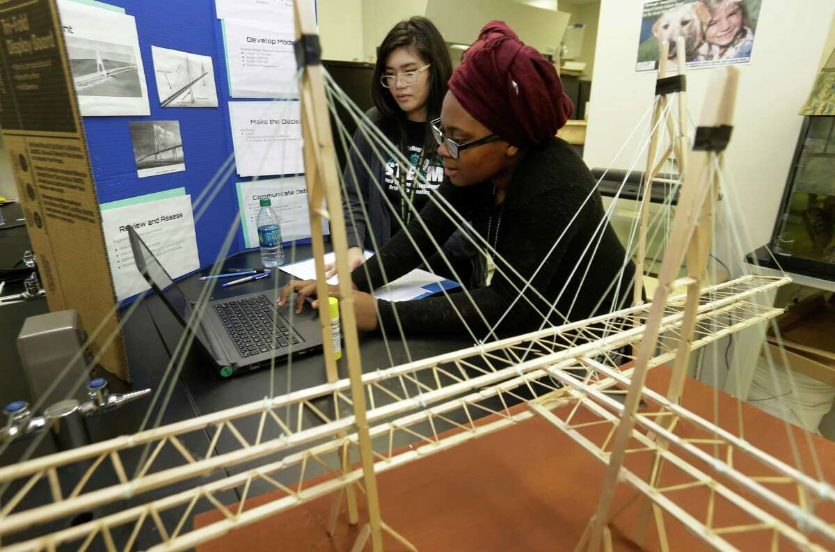Alief Early College High School, where juniors Christina Nguyen, 16, left, and Deborah Nans, 17, work on a bridge project in their Engineering Design and Problem Solving class, is nationally recognized as a Blue Ribbon School for student achievement.