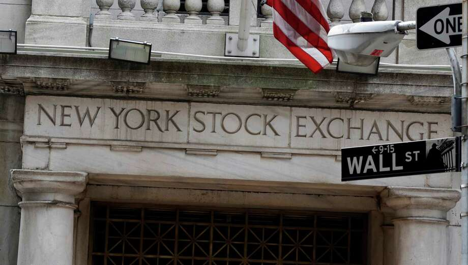 FILE - This Thursday, Oct. 2, 2014, file photo shows the Wall Street entrance of the New York Stock Exchange.  U.S. stocks are dipping Friday, Jan. 6, 2017, after a solid but unspectacular hiring report for the month of December.  (AP Photo/Richard Drew, File) Photo: Richard Drew, STF / Copyright 2016 The Associated Press. All rights reserved. This material may not be published, broadcast, rewritten or redistribu