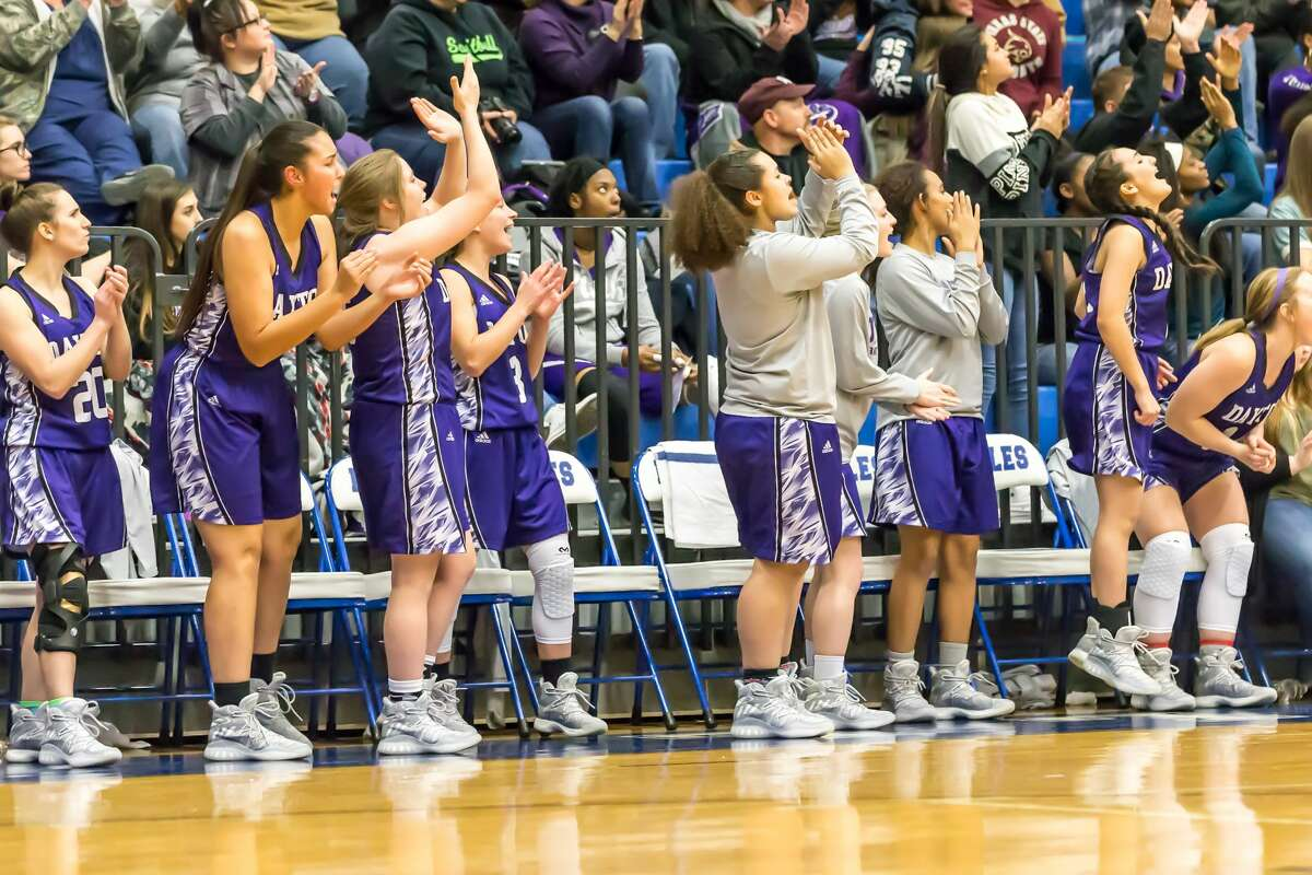 January 6, 2017: Dayton Lady Broncos varsity team cheer their players in the game against rival Barbers Hill Eagles at Barbers Hill Field House in Mont Belvieu, Texas. (Leslie Plaza Johnson/Freelance)