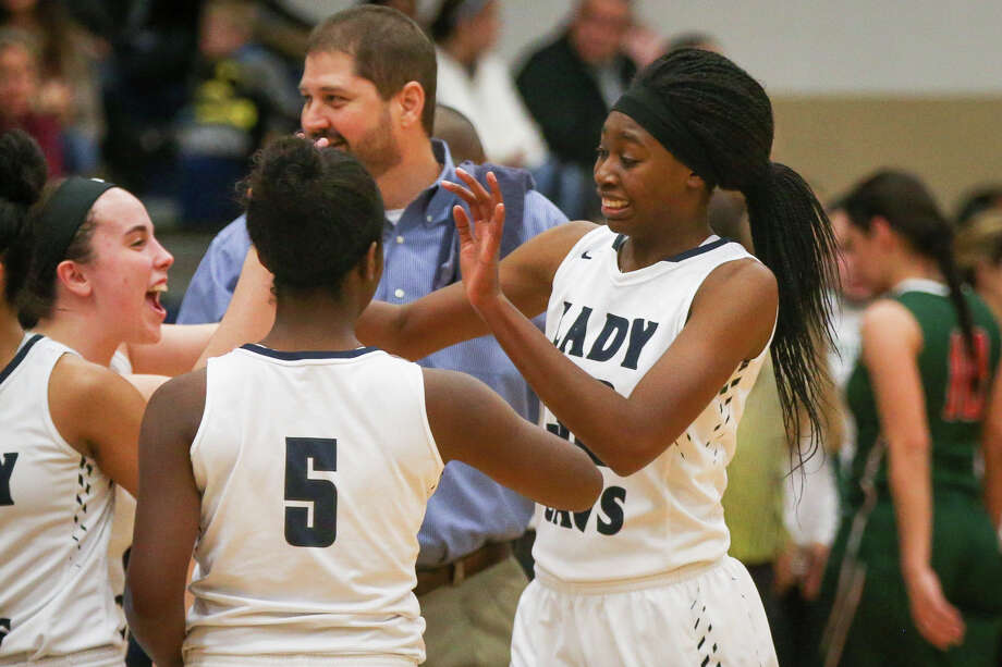 Teammates celebrate with College Park's Jasmine Atobajeun (32) during the varsity girls basketball game against The Woodlands on Friday, Jan. 6, 2017, at College Park High School. (Michael Minasi / Chronicle) Photo: Michael Minasi, Staff / © 2017 Houston Chronicle