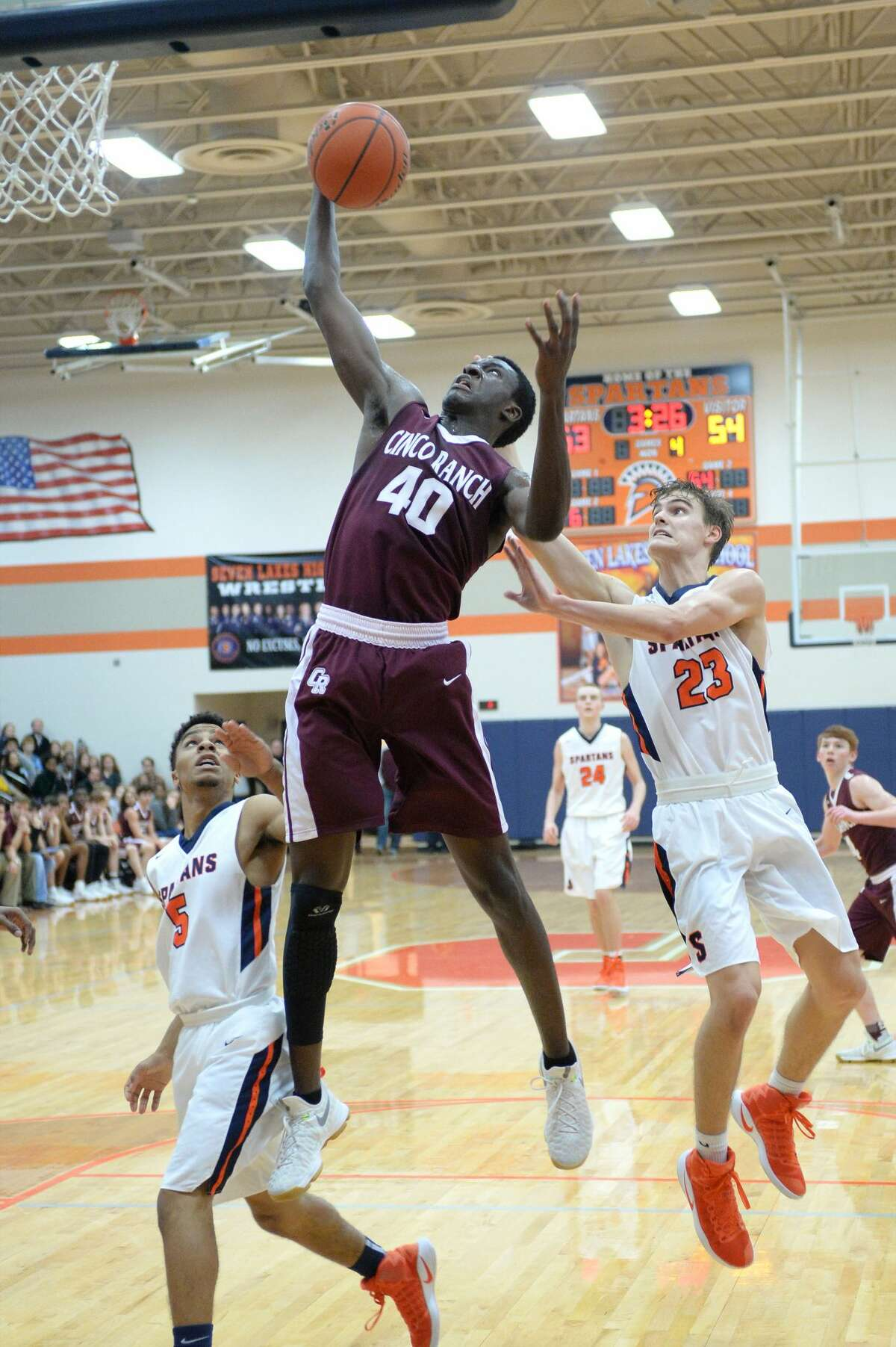 Alonzo Sule (40) of Cinco Ranch grabs a rebound in front of Jackson McClurg (23) of Seven Lakes during the second half of a boys basketball game between the Cinco Ranch Cougars and the Seven Lakes Spartans on Friday January 6, 2017 at the Seven Lakes HS, Katy, TX.