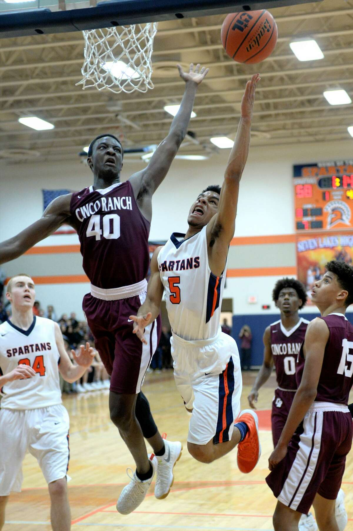 Alonzo Sule (40) of Cinco Ranch attempts to block a shot made by Logan West (5) of Seven Lakes during the second half of a boys basketball game between the Cinco Ranch Cougars and the Seven Lakes Spartans on Friday January 6, 2017 at the Seven Lakes HS, Katy, TX.