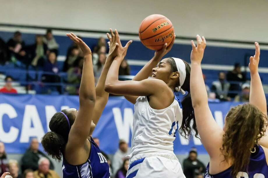 Barbers Hill's Charli Collier goes up for a shot against Dayton at Barbers Hill Field House in Mont Belvieu on Friday night. Collier finished with a game-high 31 points to lead the Eagles to a District 21-5A victory. Photo: Leslie Plaza Johnson, Freelancer / Freelance