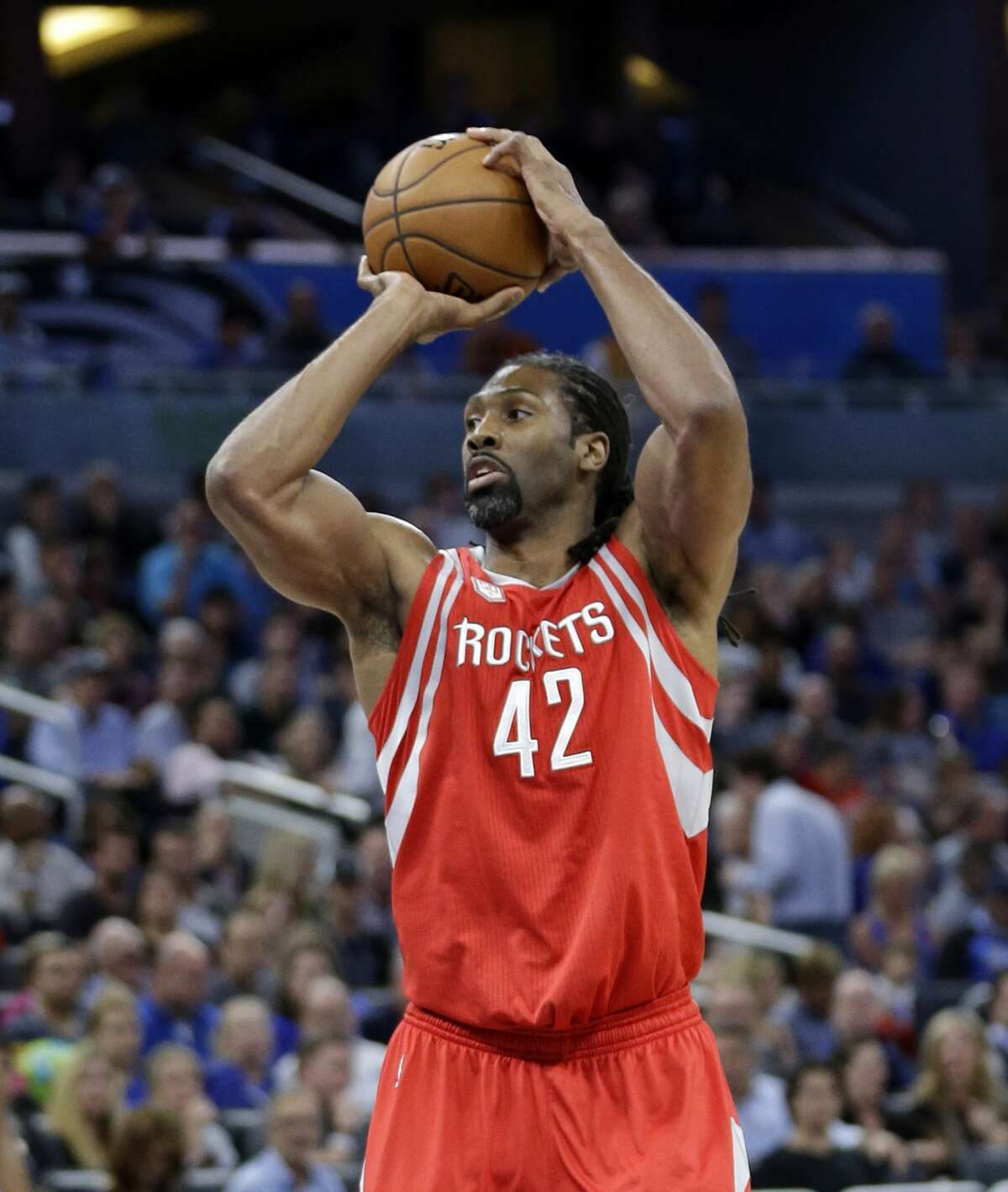 Houston Rockets' Nene takes a shot against the Orlando Magic during the first half of an NBA basketball game, Friday, Jan. 6, 2017, in Orlando, Fla. (AP Photo/John Raoux)