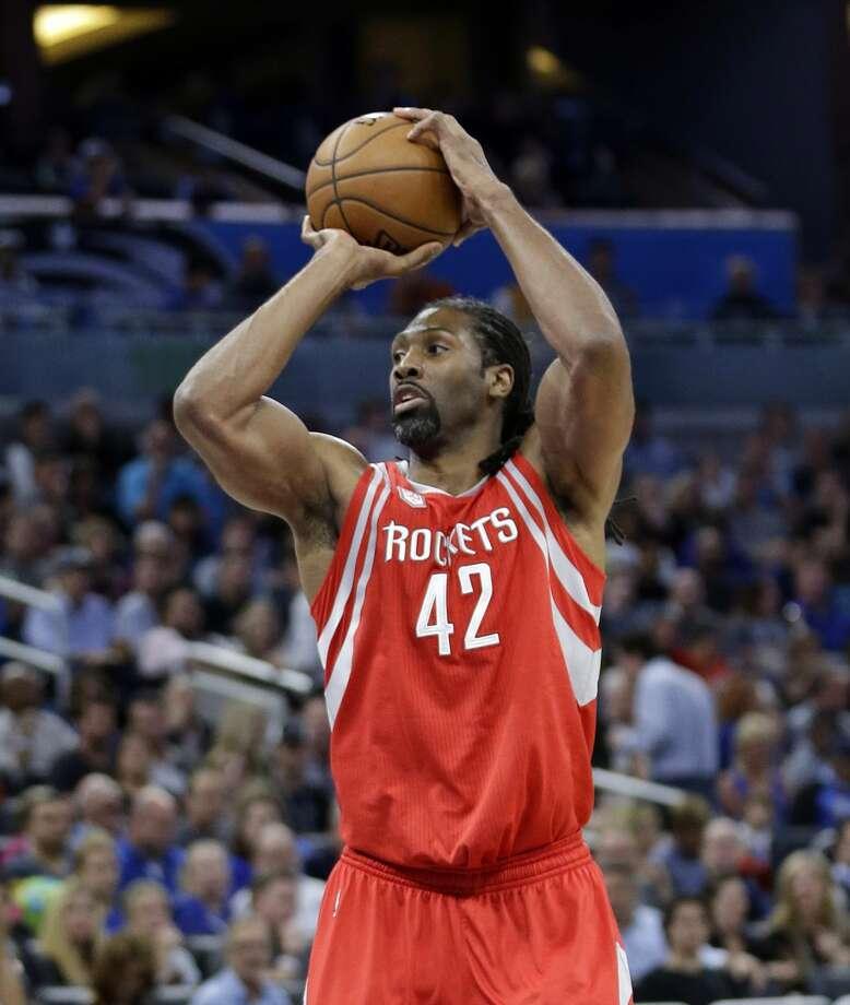 Houston Rockets' Nene takes a shot against the Orlando Magic during the first half of an NBA basketball game, Friday, Jan. 6, 2017, in Orlando, Fla. (AP Photo/John Raoux) Photo: John Raoux/Associated Press