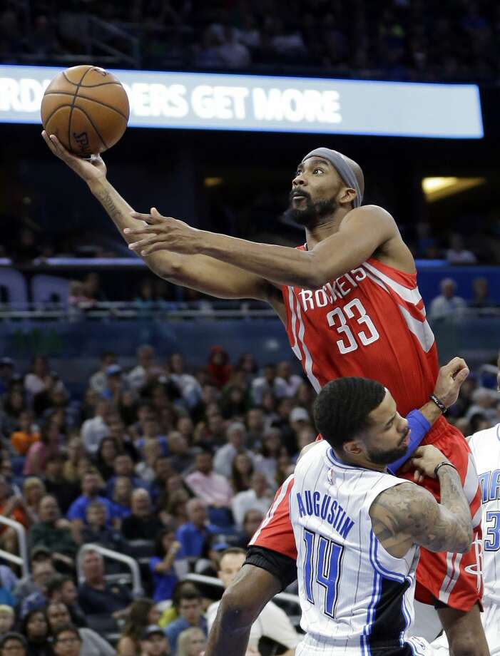 Houston Rockets' Corey Brewer (33) is called for an offensive foul as he runs into Orlando Magic's D.J. Augustin (14) while going up for a basket during the first half of an NBA basketball game, Friday, Jan. 6, 2017, in Orlando, Fla. (AP Photo/John Raoux) Photo: John Raoux/Associated Press