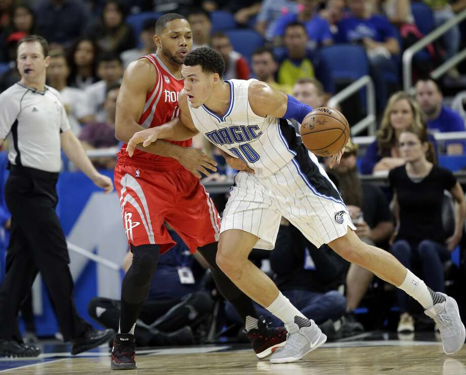 Orlando Magic's Aaron Gordon, right, makes a move to the basket against Houston Rockets' Eric Gordon during the first half of an NBA basketball game, Friday, Jan. 6, 2017, in Orlando, Fla. (AP Photo/John Raoux) Photo: John Raoux/Associated Press