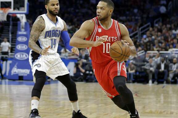 Houston Rockets' Eric Gordon (10) drives around Orlando Magic's D.J. Augustin (14) during the first half of an NBA basketball game, Friday, Jan. 6, 2017, in Orlando, Fla. (AP Photo/John Raoux)