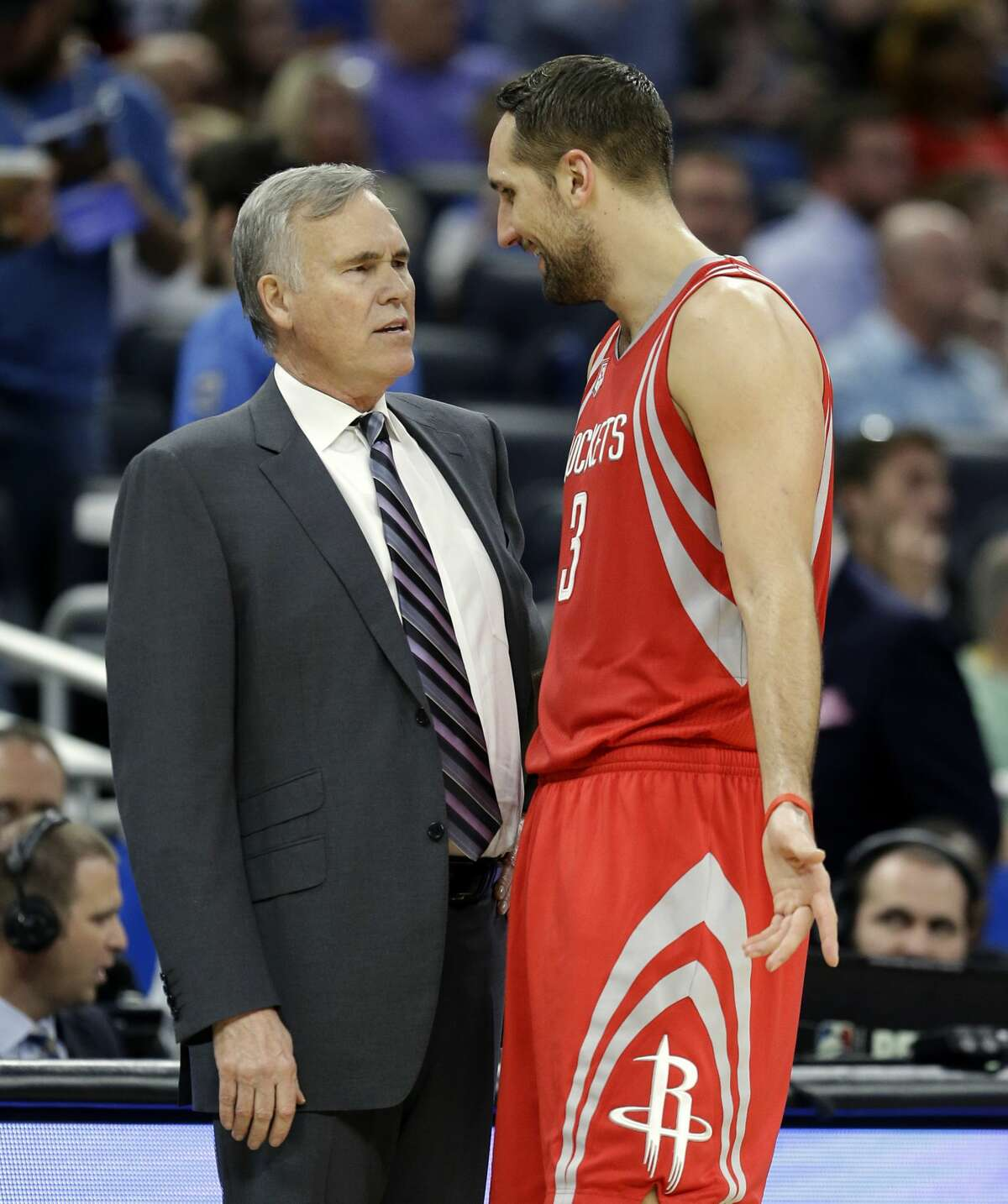 Houston Rockets head coach Mike D'Antoni, left, talks with forward Ryan Anderson during the second half of an NBA basketball game against the Orlando Magic, Friday, Jan. 6, 2017, in Orlando, Fla. Houston won 100-93. (AP Photo/John Raoux)