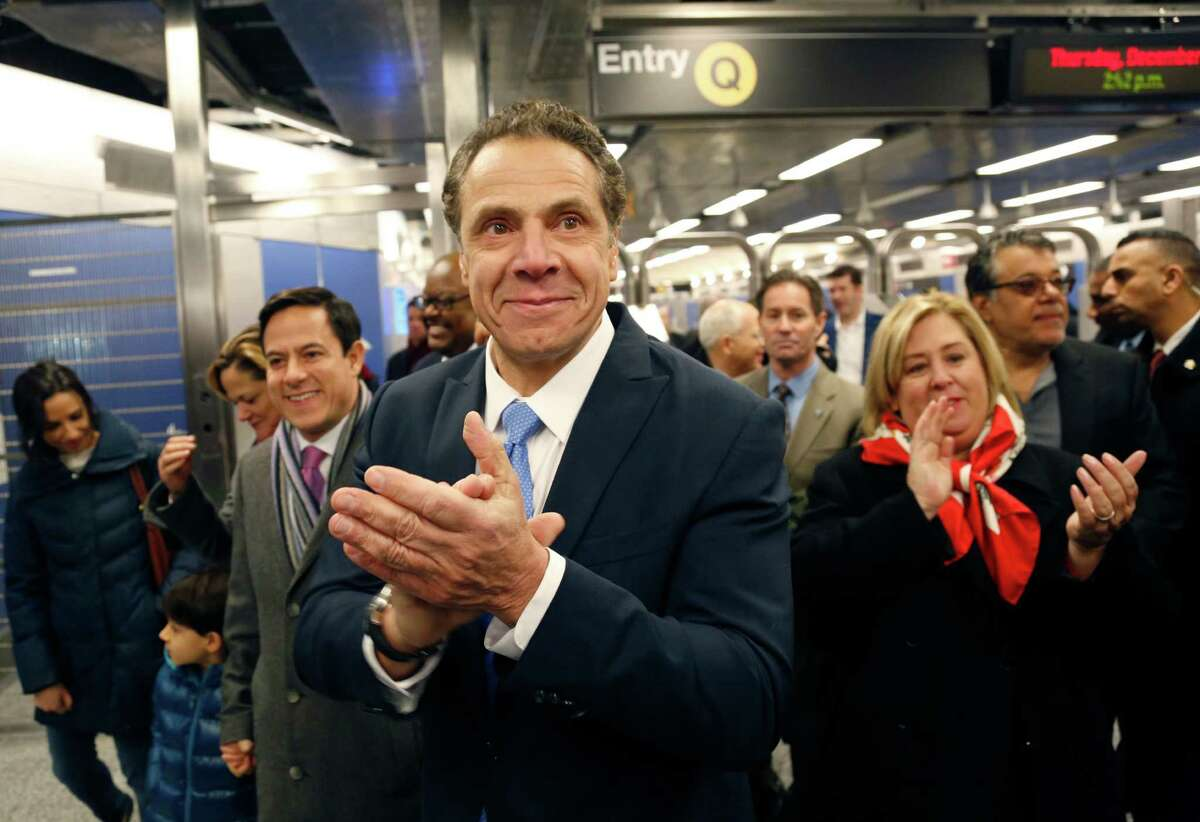 New York Governor Andrew Cuomo applauds as he greets construction workers at the new 86th Street subway station in New York, Thursday, Dec. 22, 2016. The first phase of the 2nd Avenue subway line, which has three stops, is scheduled to open on Jan. 1, 2017. (AP Photo/Seth Wenig) ORG XMIT: NYSW112