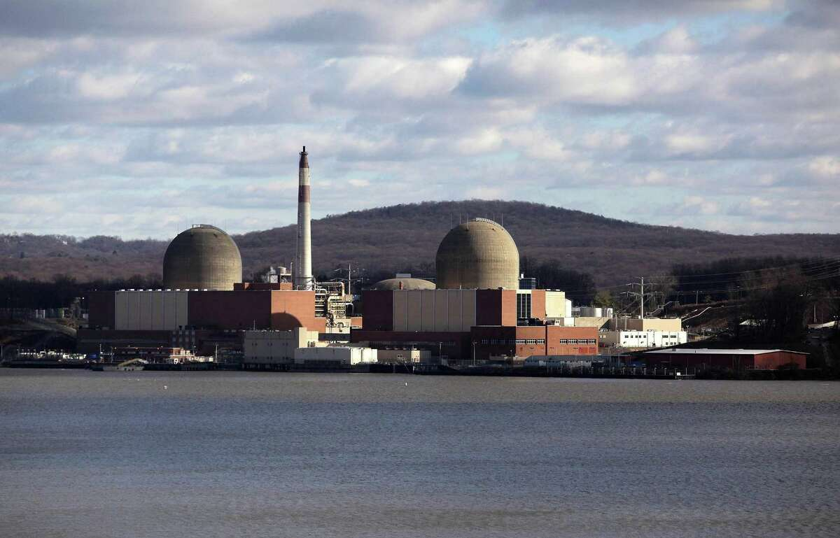 FILE - This Dec. 16, 2009, file photo, shows the Indian Point nuclear power plant in Buchanan, N.Y., as seen from across the Hudson River in Tomkins Cove, N.Y. The aging facility just north of New York City will close by April 2021 under a deal with New York Gov. Andrew Cuomo, who has long argued it should be shuttered to protect the millions of people living nearby. (AP Photo/Julie Jacobson, File) ORG XMIT: NYR105