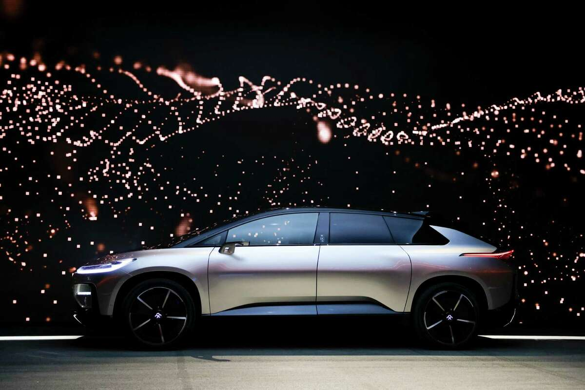 Faraday Future's FF91 electric car is unveiled during a news conference at CES International Tuesday, Jan. 3, 2017, in Las Vegas. (AP Photo/Jae C. Hong)