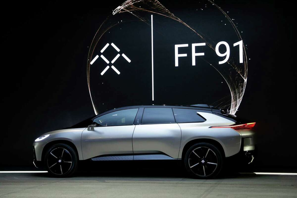Faraday Future's FF 91 electric car is unveiled during a news conference at CES International on Tuesday, Jan. 3, 2017, in Las Vegas. (AP Photo/Jae C. Hong)