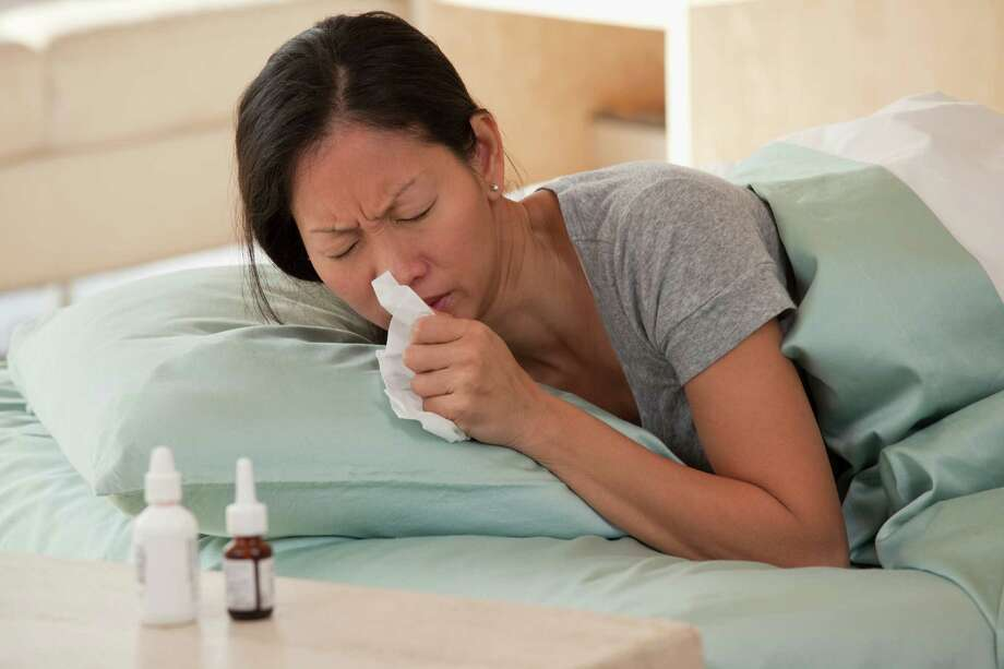California has recorded 14 flu-related deaths in people under age 65 — a marker for the severity of a flu season. Photo: Ariel Skelley / This content is subject to copyright.