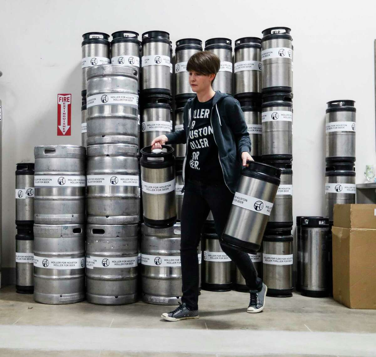Kathryn Holler moves kegs around Thursday, January 5, 2017, at the new brewery Holler Brewing. A new bill in the Texas House would force breweries looking to grow beyond a state-limited size would be forced to sell and buy back their own beer before they could offer it in their own taproom. Keep clicking to see what some of the most sought-after craft beers are in Texas.