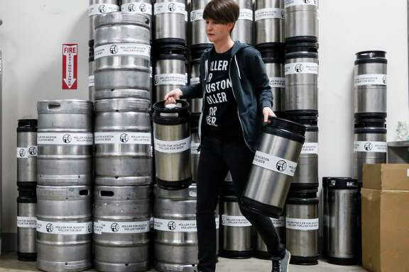 Kathryn Holler moves kegs around Thursday, January 5, 2017, at the new brewery Holler Brewing, which opened a few months ago across the street from where all the Super Bowl concerts are going to take place. They're brewing 50 percent more beer to prepare and stockpiling it. ( Karen Warren / Houston Chronicle )