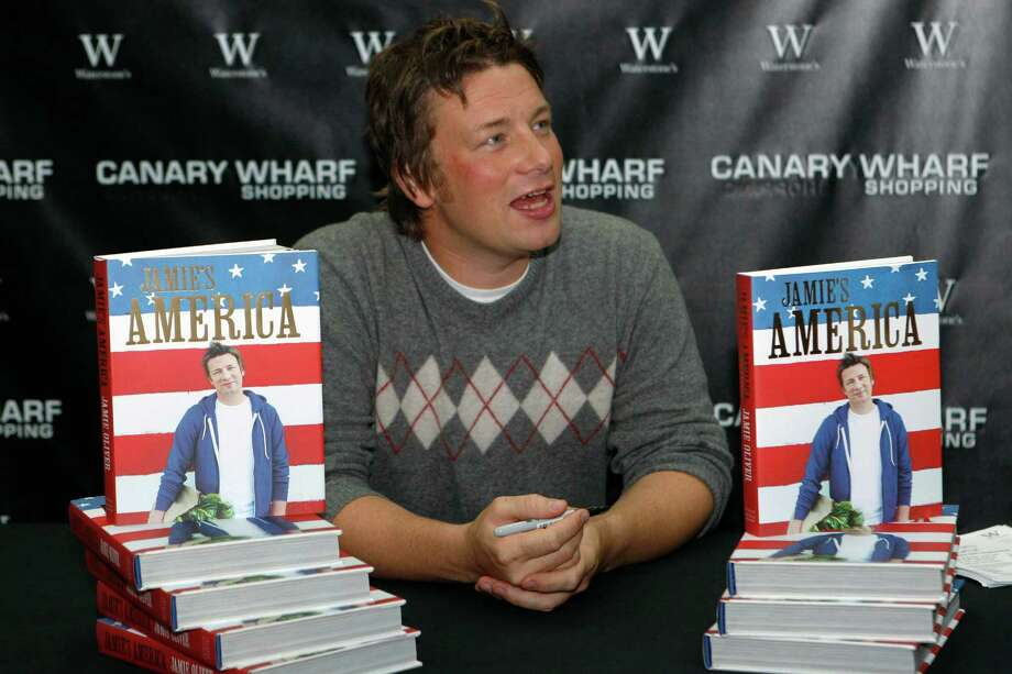 FILE - In this file photo dated Tuesday, Sept. 15, 2009, British chef Jamie Oliver during a book signing session in London. Celebrity chef Jamie Oliver is shutting six of his 42 Jamie's Italian restaurants in Britain, according to a statement issued Friday Jan. 6, 2017, amid tough trading conditions and a lower pound following Britain's Brexit vote to leave the European Union.(AP Photo/Sang Tan, FILE) Photo: SANG TAN, STR / AP2009