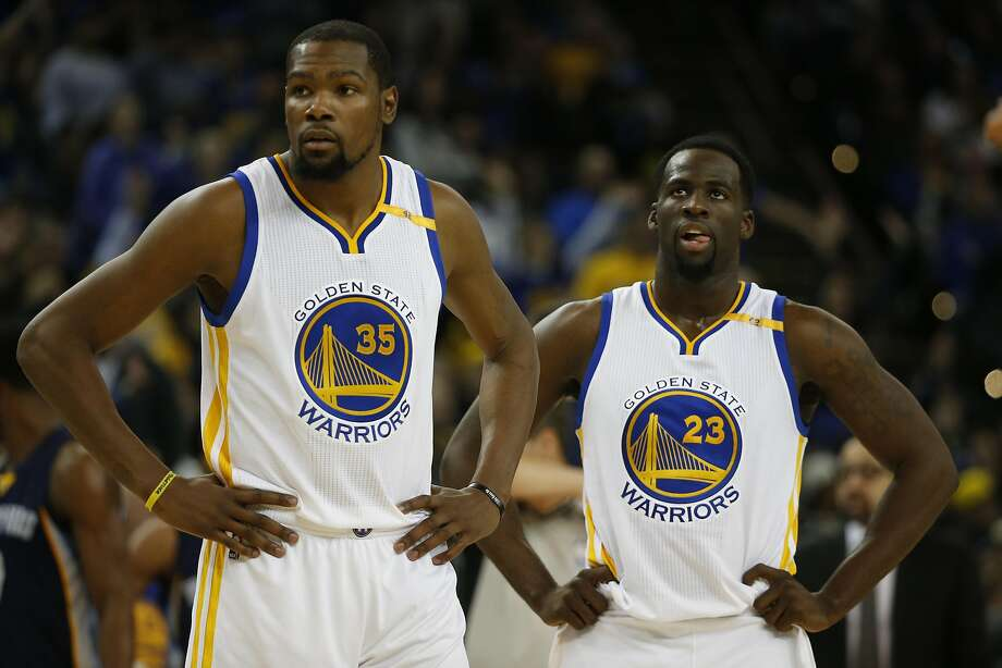 Kevin Durant (left) and Draymond Green pause in the first half of Friday loss to the Grizzlies. When Durant made a play Green thought could be better at the end of regulation, Green didn't hide his feelings, making the four-time NBA scoring champion well aware of his opionion. Head coach Steve Kerr says he isn't worried by the discord. Should fans be? Photo: Stephen Lam, Special To The Chronicle
